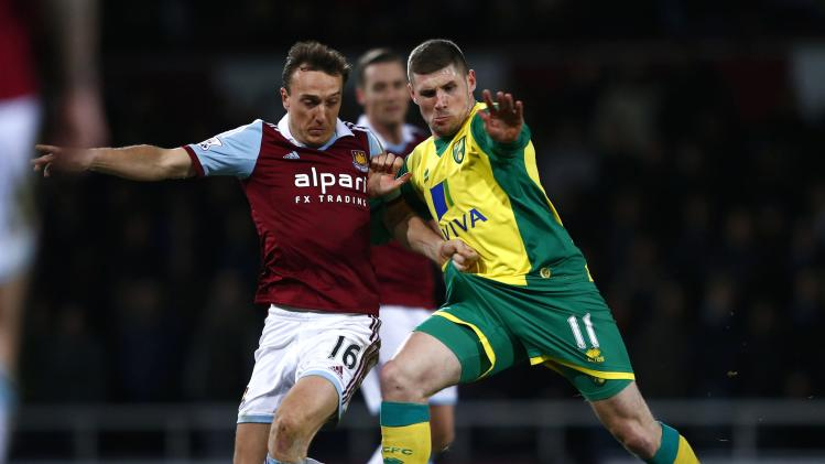 West Ham United's Noble challenges Norwich City's Hooper during their English Premier League soccer match at the Boleyn Ground in London
