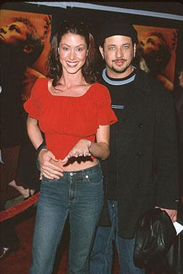Shannon Elizabeth from American Pie with the dude she's apparently enganged to at the premiere of 20th Century Fox's The Beach