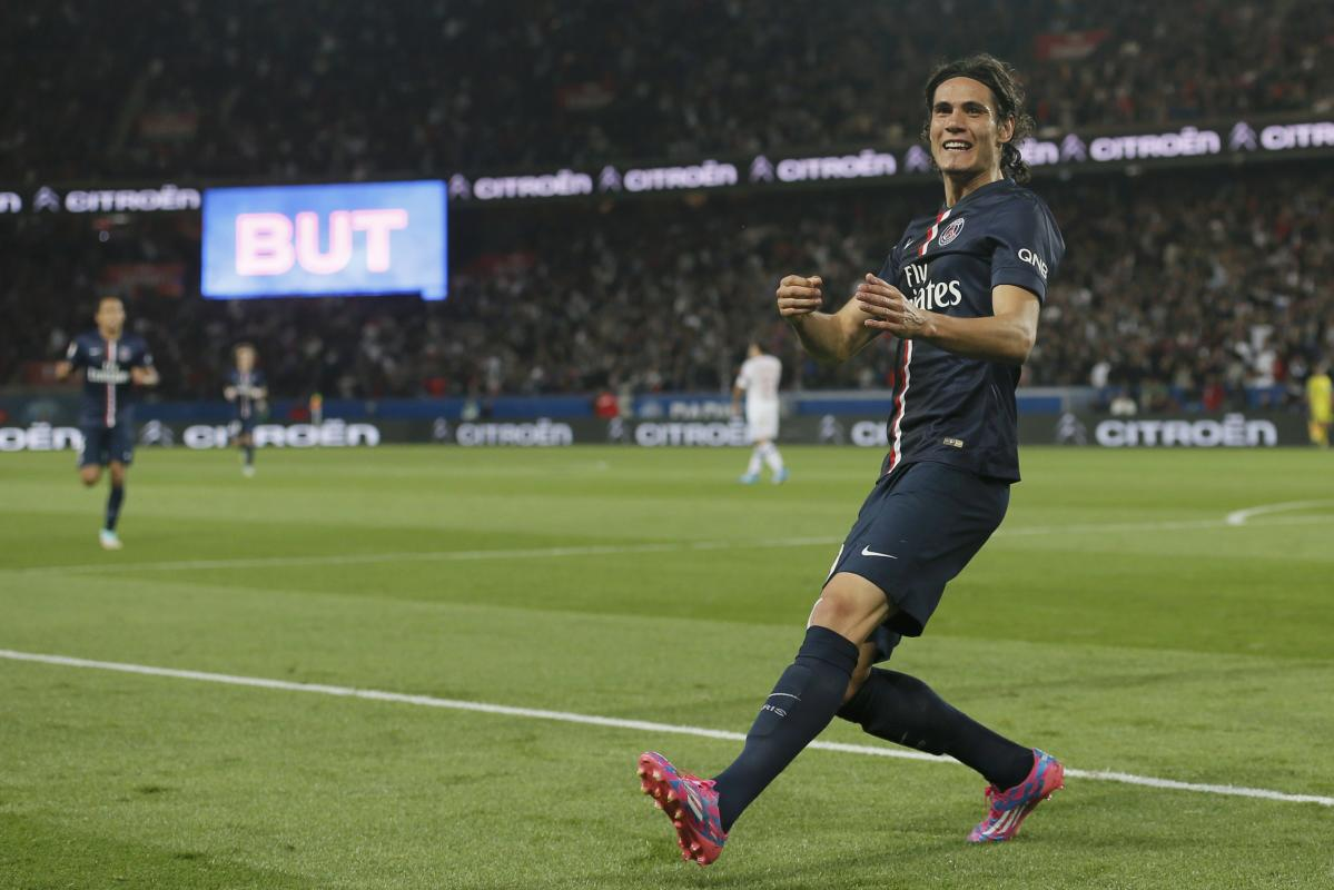 Paris St Germain's Cavani reacts after he scored against Olympique Lyon during their French Ligue 1 soccer match at the Parc des Princes Stadium...