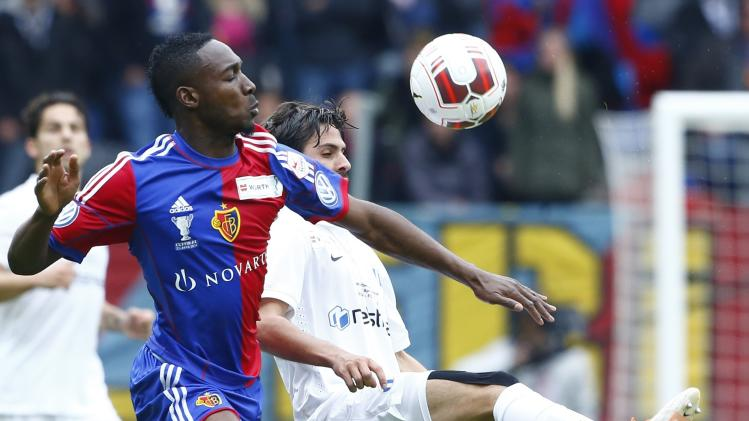 FC Basel's Sio fights for the ball with FC Zurich's Buff during their Swiss Cup final soccer match in the Stade de Suisse stadium in Bern