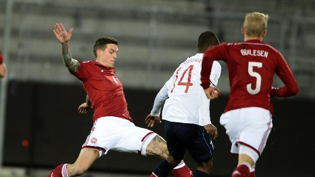 Denmark's Daniel Agger, left, and Norway's Ola Kamara, center, challenge for the ball during their international soccer match in Herning, Denmark, Friday Nov. 15, 2013