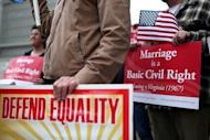 Opponents of Proposition 8, California's anti-gay marriage bill, hold signs outside a US court in San Francisco in February. Six states, including New York, plus the national capital Washington DC have legalized gay marriage