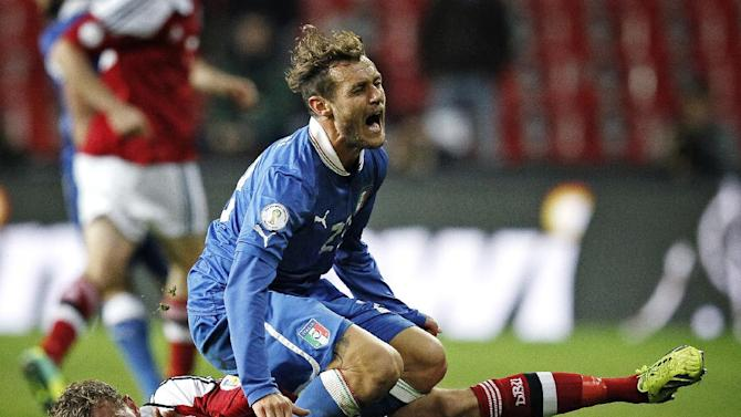 Italy's Alessandro Diamanti and Denmark's Andreas Bjelland during the 2014 World Cup Group B qualifying soccer match between Denmark and Italy at Parken Stadium in Copenhagen, Denmark, Friday Oct. 11, 2013