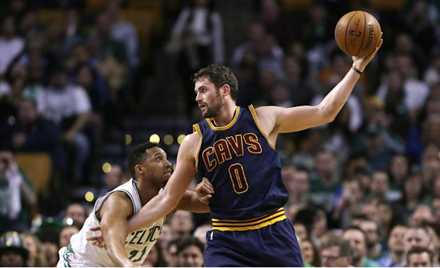 FILE - In this April 23, 2015, file photo, Cleveland Cavaliers forward Kevin Love (0) looks to pass during the first quarter of a first-round NBA playoff basketball game against the Boston Celtics in