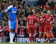 "File picture shows Liverpool players celebrating a goal during their 4-1 win at Anfield in May. Chelsea manager Roberto Di Matteo admits Liverpool have become Chelsea's ""bogey team"" ahead of the visit of Brendan Rodgers' side to Stamford Bridge on Sunday"
