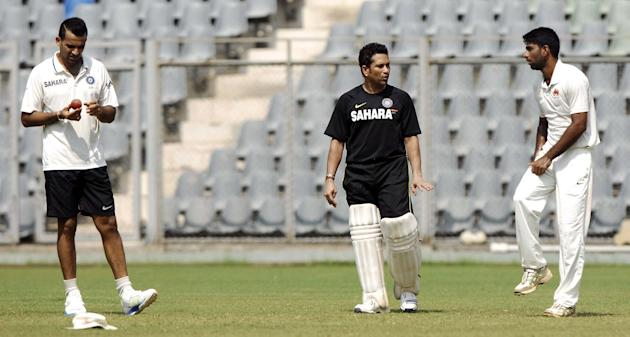 Sachin Tendulkar and Zaheer Khan practice with Mumbai team ahead of Ranji Trophy match against Haryana in Lahli, Rohtak in Mumbai on Oct.23, 2013. (Photo: Sandeep Mahankaal/IANS)