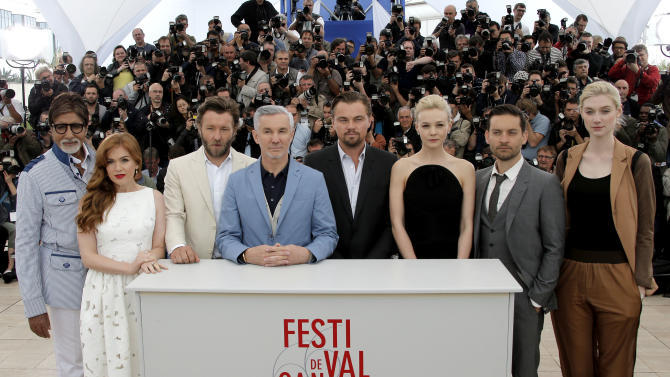 From left, actors Amitabh Bachchan, Isla Fisher, Joel Edgerton, director Baz Luhrmann, actors Leonardo Di Caprio, Carey Mulligan, Tobey Maguire and Elizabeth Debicki pose for photographers during a photo call for The Great Gatsby at the 66th international film festival, in Cannes, southern France, Wednesday, May 15, 2013. (AP Photo/Francois Mori)
