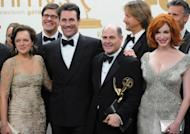 "The cast and crew of 'Mad Men' at the Emmy Awards in Los Angeles in 2011. Cult retro series ""Mad Men"" and comedy hit ""Modern Family"" are Emmys favorites again this weekend -- but a bunch of newcomers could yet produce surprises at US television's annual awards show"