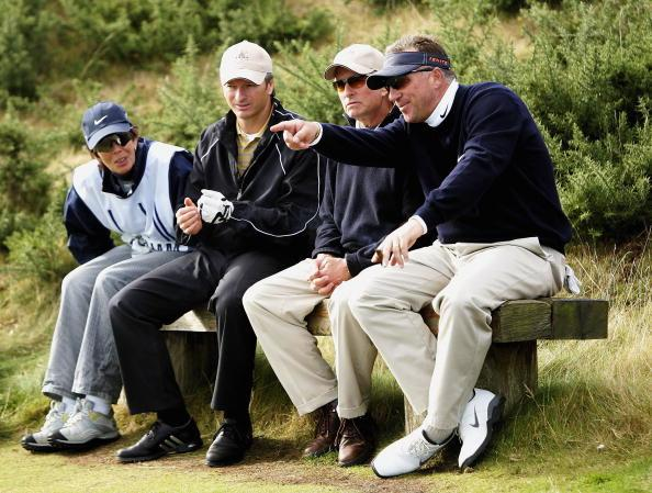 KINGSBARNS, UNITED KINGDOM - OCTOBER 1:  (R-L) Ian Botham, Michael Douglas, Steve Waugh and caddie wait to play the 12th hole during the third round of the Dunhill Links Championships at Kingsbarns Go