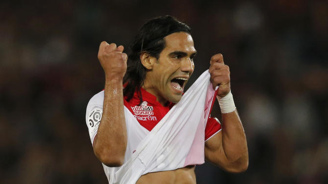 Monaco's Falcao celebrates after scoring a goal against Paris St Germain during their French Ligue 1 soccer match at the Parc des Princes Stadium in Paris