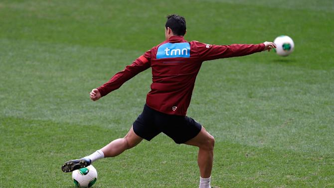 Portugal's Cristiano Ronaldo kicks a ball during a training session Sunday, Nov. 17 2013, at the Luz stadium in Lisbon. Portugal will play Sweden Tuesday in a World Cup qualifying playoff second-leg soccer match
