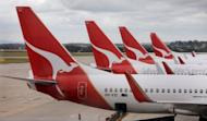 Qantas planes await passengers in Melbourne. An Australian man Friday claimed he was put on hold by Qantas Airways for so long he managed to read an entire managerial textbook, with the 15-hour phone call enough time to fly to the United States