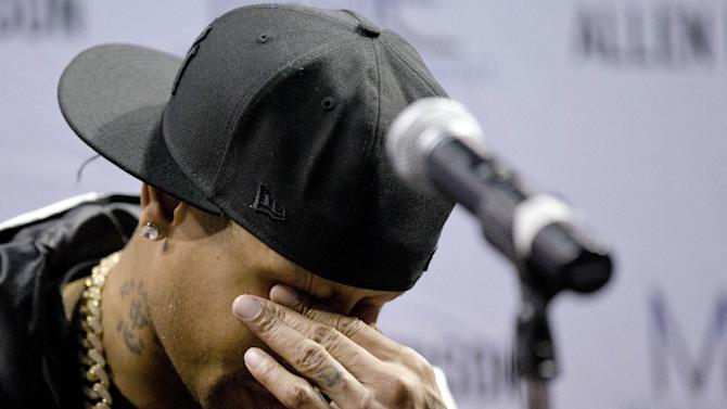 Former Philadelphia 76ers basketball player Allen Iverson wipes his eyes during a news conference Wednesday, Oct. 30, 2013, in Philadelphia. Iverson officially retired from the NBA, ending a 15-year career during which he won the 2001 MVP award and four scoring titles. Iverson retired in Philadelphia where he had his greatest successes and led the franchise to the 2001 NBA finals