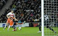 Dean Bowdich scores for MK Dons against Premier League team Queens Park Rangers at stadiummk in Milton Keynes in January. AFC Wimbledon have urged the Milton Keynes club to drop the word 'Dons' from their official club name ahead of what promises to be a highly-charged FA Cup tie between the two clubs next month