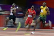 L-R: Canada's Aaron Brown, USA's Isiah Young and Jamaica's Usain Bolt compete in the men's 200m semi-finals at the athletics event of the London 2012 Olympic Games in London