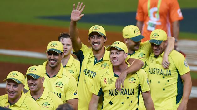 Australia's Mitchell Starc waves to the crowd after their seven wicket win over New Zealand in the Cricket World Cup final in Melbourne, Australia, Sunday, March 29, 2015. (AP Photo/Andy Brownbill