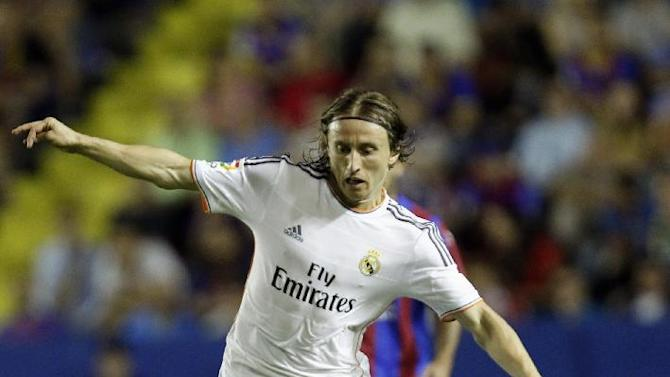 Real Madrid's Luka Modric from Croatia duels for the ball with Levante's Pape Diop during their La Liga soccer match at the Ciutat de Valecia stadium in Valencia, Spain, Saturday, Oct. 5, 2013