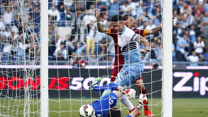 Lazio's Dordevic scores past AS Roma goalkeeper De Sanctis during their Serie A soccer match at the Olympic stadium in Rome