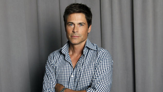 "FILE - This April 25, 2012 file photo shows actor Rob Lowe posing for a portrait in New York. Lowe will will portray President John F. Kennedy in a National Geographic film about the former president's 1963 assassination. The National Geographic Channel said Tuesday, May 28, 2013, that filming for ""Killing Kennedy"" would begin next month in Richmond, Va. The film is expected to air around the 50th anniversary of the shooting later this year and is based on the book by Bill O'Reilly. (AP Photo/Amy Sussman, file)"