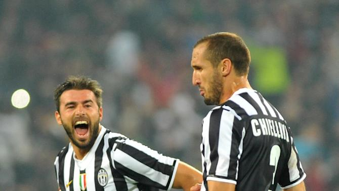Juventus defender Giorgio Chiellini, right, celebrates after scoring during a Serie A soccer match between Juventus and AC Milan at the Juventus stadium, in Turin, Italy, Sunday, Oct. 6, 2013