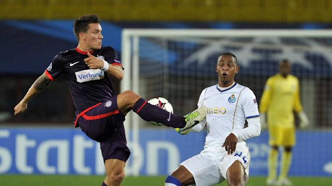 Austria's Marko Stankovic, left, and Porto's Fernando challenge for the ball during the Champions League first round group G soccer match between FK Austria Vienna and FC Porto in Vienna, Austria, Wednesday, Sept. 18, 2013