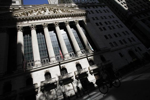 FILE - This July 15, 2013 file photo shows the New York Stock Exchange in New York.  Global stock markets fell sharply Friday, Sept. 4, 2015,  ahead of the release of monthly U.S. jobs figures that co
