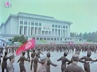 """A screen grab taken from North Korean TV on Wednesday shows North Korean soldiers dancing in a plaza after an announcement of North Korean leader Kim Jong-Un's new title of 'Marshal' in Pyongyang. North Korea said Friday it had no choice but to """"completely review"""" the nuclear issue after accusing the United States and South Korea over a plot to blow up a statue of its founding leader"""