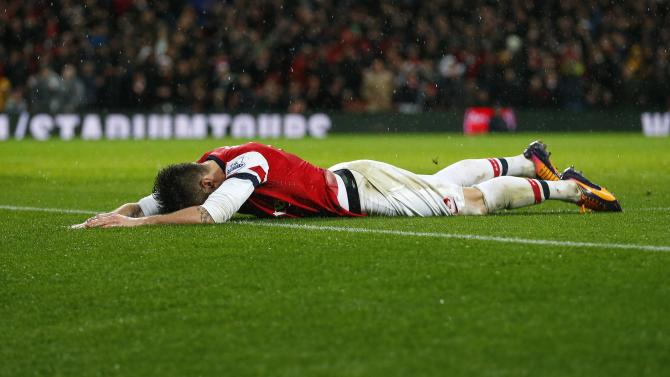 Arsenal's Giroud reacts after missing a chance to score during their English Premier League soccer match against Chelsea at The Emirates in London