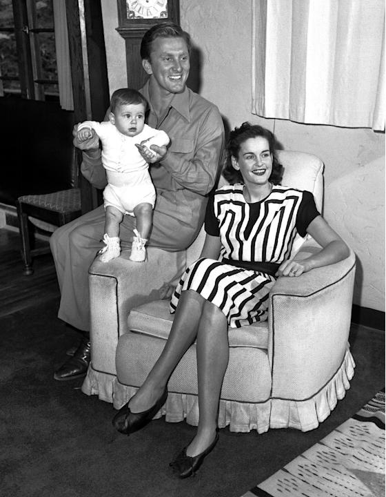 FILE - In this Sept. 9, 1947 file photo, actors Kirk and Diana Douglas pose with their second son, Joel, for his first portrait in the Hollywood district of Los Angeles.  Diana Douglas, the first wife