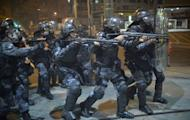 Anti riot police charge during a protest in a street near the Maracana stadium of Rio de Janeiro on June 30, 2013. More than 11,000 police and troops were mobilized to ensure security for 78,000 fans at the Maracana arena