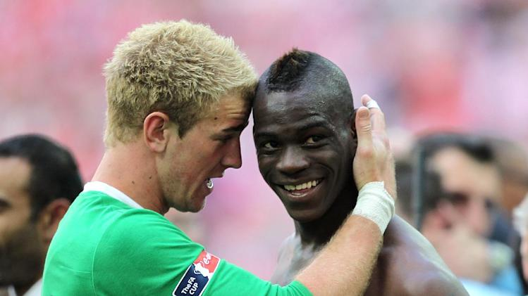 Joe Hart (left) insists the jokes are on hold with Italy's Mario Balotelli