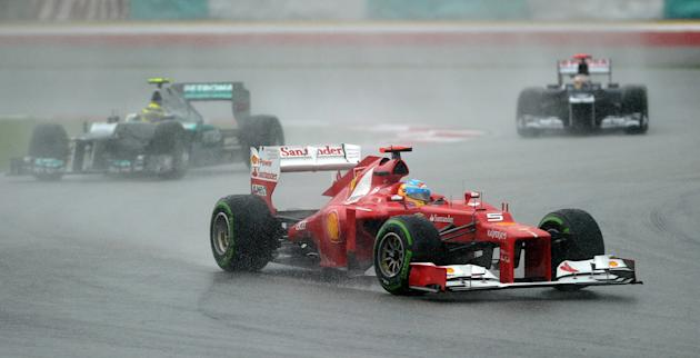 Ferrari driver Fernando Alonso of Spain powers his car during Formula One's Malaysian Grand Prix at the Sepang International Circuit in Sepang on March 25, 2012. AFP PHOTO/ Prakash SINGH (Photo credit