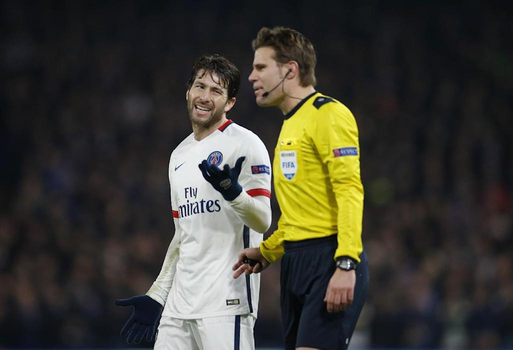 PSG's Maxwell talks with referee Felix Brych