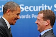 US President Barack Obama and his Russian counterpart Dmitry Medvedev share a joke after their bilateral meeting on the sidelines of the Nuclear Security Summit in Seoul. President Barack Obama said Monday the United States would further cut its own nuclear stockpiles, as he warned North Korea and Iran to back down over their atomic plans