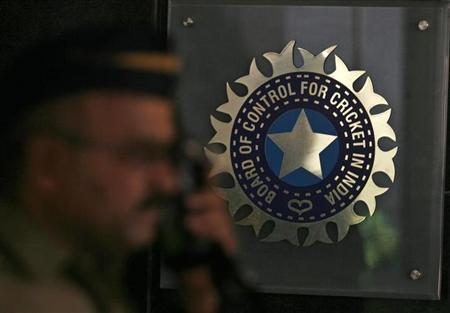 A policeman walks past a logo of the Board of Control for Cricket in India (BCCI) during a governing council meeting of the Indian Premier League (IPL) at BCCI headquarters in Mumbai April 26, 2010. R