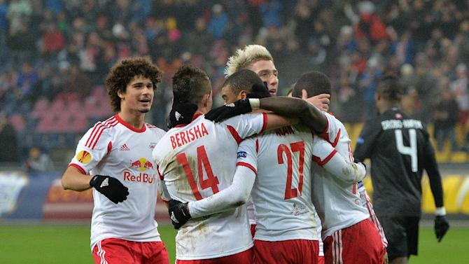 Salzburg's players celebrate after scoring  during the Europa League group C soccer match  between Red  Bull Salzburg and Esbjerg fB  in Salzburg , Austria, Thursday, Dec  12, 2013