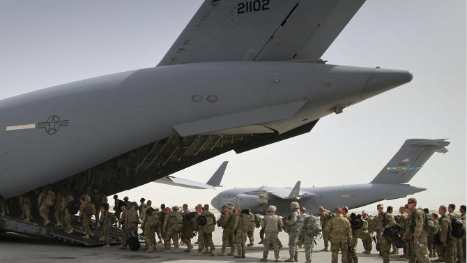 U.S. soldiers board a U.S. military plane, as they leave Afghanistan, at the U.S. base in Bagram north of Kabul, Afghanistan. The United States is not alone in pulling combat troops off the Afghan battlefield. More than a dozen other countries have draw down plans that combined with the U.S. withdrawal will shrink the foreign military footprint in Afghanistan by more than 40,000 troops by the close of next year. (AP Photo/Musadeq Sadeq, File)