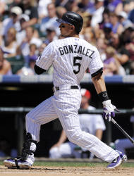 Colorado Rockies' Carlos Gonzalez hits a three-run double in the fifth inning of an interleague baseball game against the Kansas City Royals in Denver on Sunday, July 3, 2011. The Royals won 16-8. (AP Photo/Chris Schneider)
