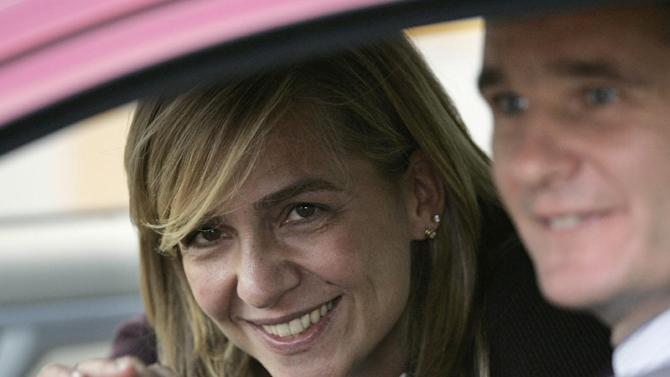 FILE- Spain's Princess Cristina waves from inside a car beside her husband Inaki Urdangarin, in Madrid, Spain, in this file photo dated Wednesday Nov. 2, 2005. A Spanish court has named the king's daughter Princess Cristina Wednesday April 3, 2013, as a suspect in an alleged corruption case involving her husband, and the court has announced that it will call her for questioning. The Spanish royal palace refused to comment.  (AP Photo/Daniel Ochoa de Olza, File)