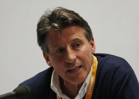 British politician and former athlete Sebastian Coe talks to the media