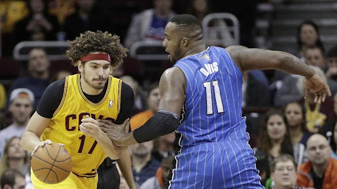 Cleveland Cavaliers' Anderson Varejao (17), from Brazil, drives past Orlando Magic's Glen Davis (11) during the fourth quarter of an NBA basketball game Thursday, Jan. 2, 2014, in Cleveland. The Cavaliers won 87-81