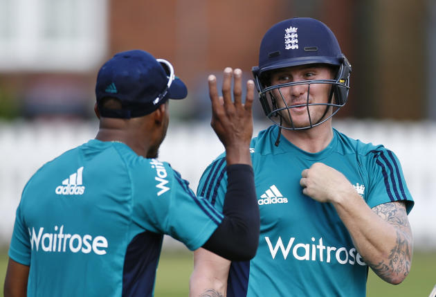 England's Chris Jordan and Jason Roy (R) during nets
