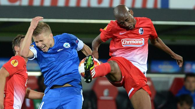 Gelson Fernandes, right,  of Freiburg and Martin Frydek , left, of Liberec challenge  for the ball during the UEFA Europa League Group H  soccer match between SC Freiburg and Slovan Liberec FC  in Freiburg, Germany Thursday Sept. 19, 2013
