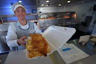 A portion of fish and chips is served at a Fish and Chip Takeaway in Manchester, north-west England, on March 10, 2010. Feeding 10,500 athletes and millions of fans during the Olympics may be a mammoth task but London 2012 is hoping to seize the opportunity to also improve the reputation of British cuisine
