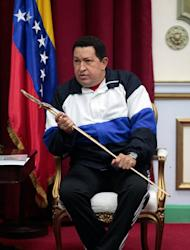 Venezuelan President Hugo Chavez holds a replica of Liberator Simon Bolivar's sword, on December 10, 2012 in Caracas. Chavez, who was re-elected president in October, has picked Nicolas Maduro to fill in should his cancer make it impossible for him to be sworn in for a new term on January 10