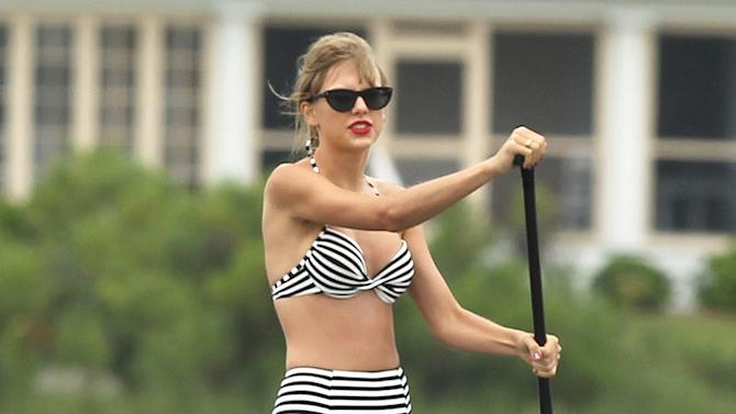 Taylor Swift and Ed Sheeran enjoy a day of paddle boarding in Westerly, RI