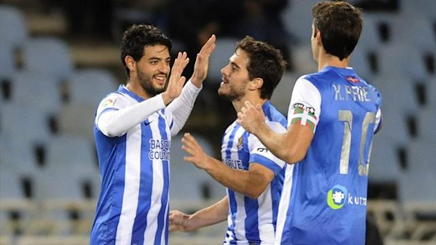 Real Sociedad's Mexican forward Carlos Vela (L) is congratulated by teamates (AFP)