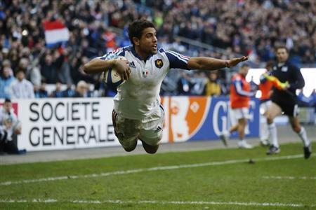 France's Wesley Fofana jumps to score a try against Italy during their Six Nations rugby union match at the Stade de France in Saint-Denis, near Paris