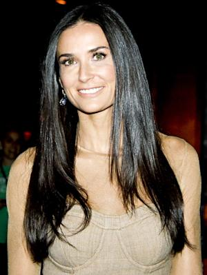 Report: Demi Moore Leaves Rehab, Goes on Secret Vacation