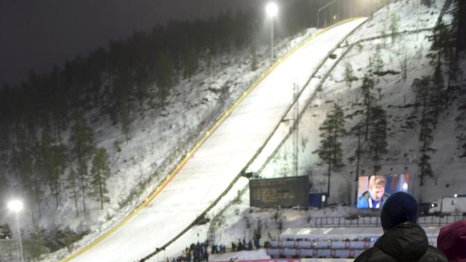 Coaches leave the ski jumping hill after the ski jumping competition in Ruka was canceled due to bad weather, at the FIS World Cup Ruka Nordic 2015 event